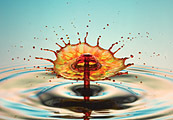 A drop of colored water splashing